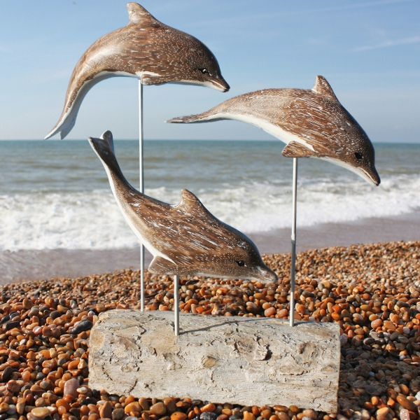 Dolphin family wood carving marine